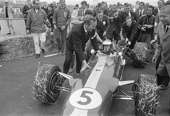 Jim Clark being congratulated by Colin Chapman after winning with the 1967 Dutch Grand Prix, the Lotus 49's first World Championship race