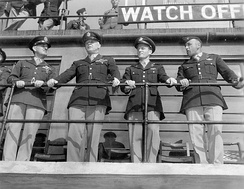 Senior USAAF personnel including Colonel Stone and General Hap Arnold on the control tower at Duxford, 1943