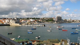 The coast of the civil parish of Estoril, showing a mix of modern and historical architecture, as well as its fishing history