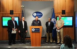 Federal Emergency Management Agency (FEMA) Administrator David Paulison (center) with various United States' federal officials and other response leaders on August 30.