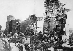 French soldiers under General Gouraud, with machine guns amongst the ruins of a cathedral near the Marne, 1918.