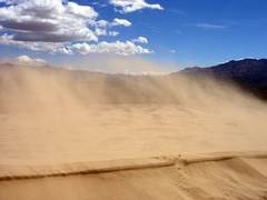 Sand blowing off a crest in the Kelso Dunes of the Mojave Desert