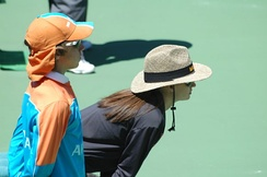 Ball boy (left) and line judge (right) during the 2005 Australian Open.
