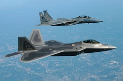 The first operational F-22A Raptor alongside a F-15D Eagle on its delivery flight to Langley AFB in May 2005.