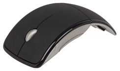"A Microsoft wireless Arc Mouse, marketed as ""travel-friendly"" and foldable but otherwise operated exactly like other 3-button wheel-based optical mice"