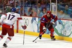 Alexander Ovechkin of the Russian men's hockey team moves the puck as Czech Republic's Filip Kuba defends against him, during the 2010 Olympics