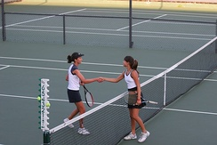 Convention dictates that two players shake hands at the end of a match