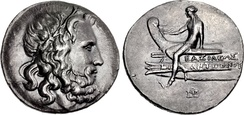 A tetradrachm minted during the reign of Antigonus III Doson (r. 229–221 BC), possibly at Amphipolis, bearing the portrait image of Poseidon on the obverse and on the reverse a scene depicting Apollo sitting on the prow of a ship