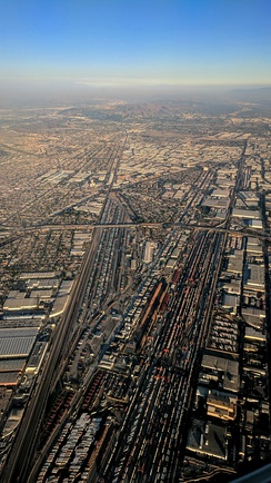 Late afternoon aerial photograph from the west, of rail yards in Commerce, left, and Vernon, right. The upper center industrial/commercial area is mostly Commerce.