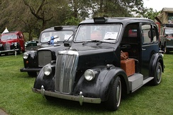 Until the late 1950s, vehicles licensed as London taxis were required to be provided with an open-access luggage platform in place of the front passenger seat found on other passenger cars (including taxis licensed for use in other British cities).