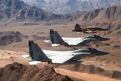 An air-to-air view of two U.S. Air Force F-15C Eagle fighter aircraft from the 33rd Tactical Fighter Wing, Eglin Air Force Base, Florida, and a Royal Saudi Air Force F-5E Tiger II fighter aircraft during a Operation Desert Storm mission.