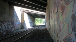 Replete with interesting graffiti, the M&M Trail passes beneath the Mass Pike along with the railroad