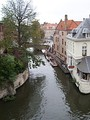An aerial view over one of Bruges' canals.