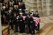 The casket of President Gerald R. Ford is carried past a group that includes President George W. Bush, First Lady Laura Bush and former Presidents George H.W. Bush, Bill Clinton, and Jimmy Carter at the National Cathedral in Washington January 2, 2007.
