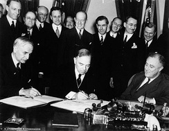 Signing of the United States-Canada Trade Agreement. (Seated, L-R) by Cordell Hull, William L. M. King and Franklin D. Roosevelt in Washington, on November 16, 1935.