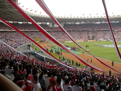 Football match at Gelora Bung Karno Stadium.