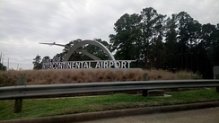 An entrance sign for the airport