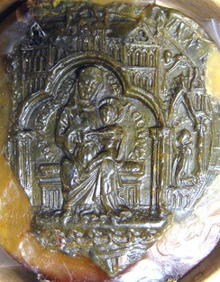 Chapter seal of Gisborough Priory, 1538. The seal depicts the Virgin Mary with the infant Christ, sitting under a canopy in the shape of a church.