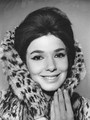 Graciela Borges, Argentine fashion icon of the 1960s, wearing a fur coat, bouffant hair and winged eye liner.