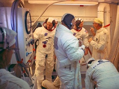 Wendt (right, standing) with the Apollo 11 crew (Collins, Aldrin, Armstrong) in the LC-39A white room
