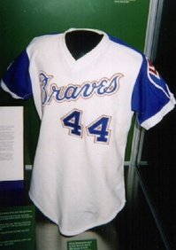 "The jersey Hank Aaron wore when he broke Babe Ruth's home run record on display in the museum's ""Atlanta"" exhibit"