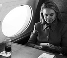 Hillary Clinton playing a Game Boy in 1993