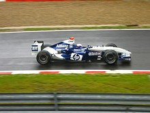 After Juan Pablo Montoya (top) won the 2004 Brazilian Grand Prix, Williams went eight years without a victory until Pastor Maldonado (bottom) won the 2012 Spanish Grand Prix.