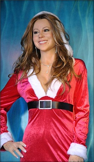 "A Christmas-themed wax statue of Carey at Madame Tussauds San Francisco, reflecting her title of ""Queen of Christmas"""