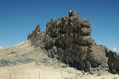 A dike of lamprophyre near the Shiprock volcanic plug, New Mexico, that has resisted the erosion that removed some of the softer rock into which the dike was originally intruded