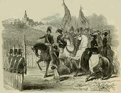 On horseback, Smith leads soldiers bearing flags