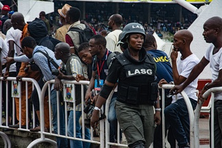 A Nigerian police officer at the Eyo festival in Lagos