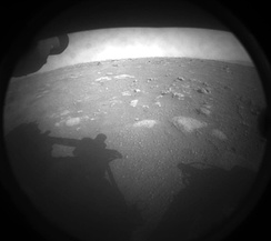 First image acquired moments after landing of Perseverance, from Front Left Hazard Avoidance Camera, 18 February 2021