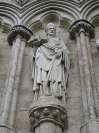 Sculpture on the west front of the cathedral of Richard Poore who oversaw the early years of its construction, beginning in 1220. He is holding a model of the cathedral