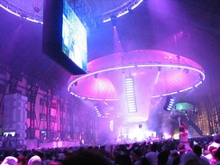 A rave held in a warehouse-sized venue, with elaborate lighting and powerful sound system.