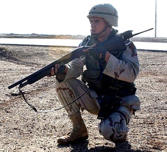 A United States Army soldier armed with a Mossberg 500 shotgun