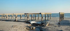 Stripped boardwalk in Rockaway Beach after Hurricane Sandy in 2012