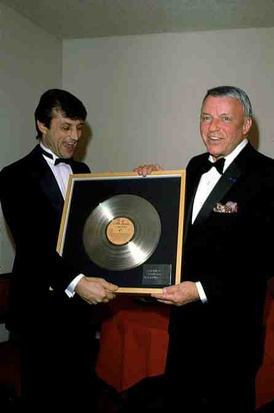 Tony Renis and Frank Sinatra celebrating a Gold record in 1985.
