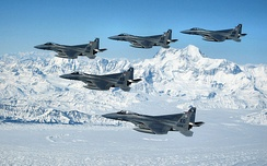 Five F-15Cs from the 33d Fighter Wing of Eglin Air Force Base fly over an Alaskan mountain range during a deployment to Elmendorf Air Force Base, Alaska.