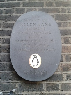 The plaque marking the fiftieth anniversary of the founding of Penguin Books by Allen Lane at 8 Vigo Street.