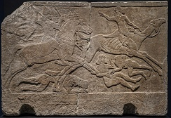 Assyrian relief depicting battle with camel riders, from Kalhu (Nimrud) Central Palace, Tiglath Pileser III, 728 BCE, British Museum