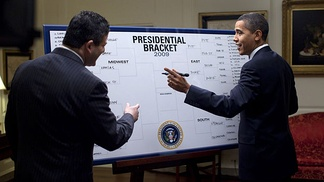 "President Obama fills out his picks for the NCAA Men's Div I Tournament with ESPN's Andy Katz. President Barack Obama picked North Carolina to win the National Championship when he shared his ""Barack-etology"" with Katz on March 18, 2009. Other teams in his Final Four were Pittsburgh, Louisville, and Memphis.[1]"