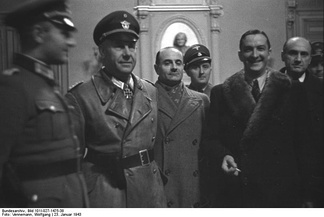 French police head René Bousquet, in fur-trimmed coat, posing with Nazi German officials