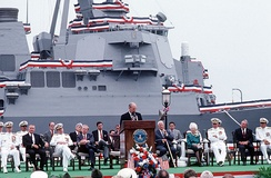 Secretary of Defense Cheney delivering a speech before the launch of destroyer USS Arleigh Burke