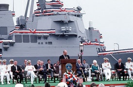 Senator Robb and fellow Virginia Senator John Warner at the commissioning ceremony for the USS Arleigh Burke with Arleigh Burke and wife present and Secretary of Defense Dick Cheney delivering the keynote address on July 4, 1991.