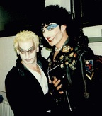 David Nehls (left) as Riff Raff and William E. Lester as Frank-N-Furter in the 1996 European tour of The Rocky Horror Show