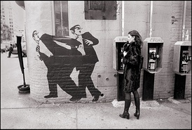 A wall in the East Village in 1998, featuring a mural of two men