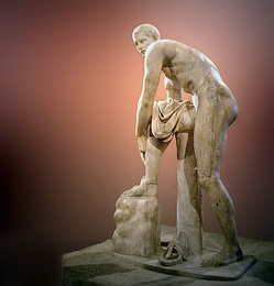 Hermes Fastening his Sandal, early Imperial Roman marble copy of a Lysippan bronze (Louvre Museum)
