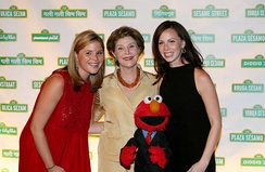 Jenna Hager (left), with her mother, her twin sister, and Elmo, at the Sesame Workshop Fifth Annual Benefit Dinner