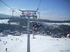 A view of a typical ski resort and ski lifts