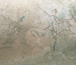 San rock art depicting a shield-carrying Bantu warrior. The movement of Bantu settlers, who migrated southwards and settled in the summer rainfall regions of Southern Africa within the last 2000 years, established a range of relationships with the indigenous San people from bitter conflict to ritual interaction and intermarriage.